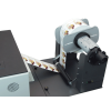 Optional motorized rewinder processes traditional roll-to-roll labels, rewinding face-in or face-out, for convenience