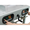Two-button operation automatically engages clamp and blade, keeping hands away from the cutting area