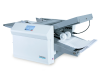 Telescoping outfeed stacker in closed position for small spaces, can be extended to hold up to 500 folded sheets