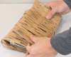 Produce flexible cardboard webbing which is easy to wrap around items for shock-absorbing protection in transit