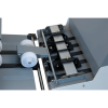 Guide wheels and six-ball-roller deck ensure forms enter the stacker smoothly